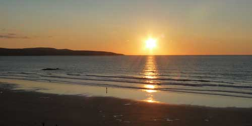 touring cornwall campervan - sunset gwithian beach